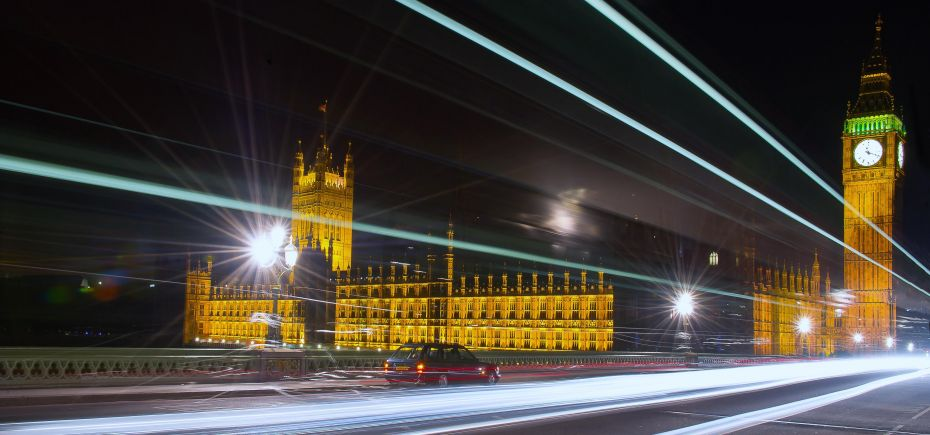 westminster bridge with light trails and showing houses of parliament