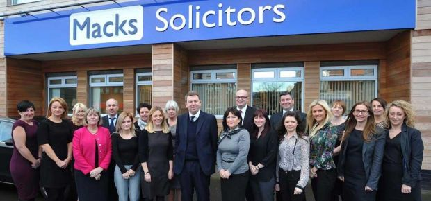 Senior Wills and Probate solicitor Lynda Monks, fourth from right, with Macks' colleagues