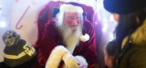 Santa meeting children at his grotto at Castlegate Shopping Centre