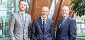 Head of busines legal services, Rob Moore (centre), welcomes Richard Dale (left) and James Parden (r