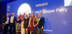 The PKF Cooper Parry team collecting their award from the British Accountancy Awards 2016 host, John