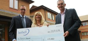 Chris Morley, Finance Director with Vinny O'Dowd, Managing Director of Bethell Contruction donate fu