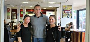 Twins Emma and Holly Westerside with Richard Sutton
