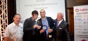 Mechan's Lee Pitts and Adam Elliott (centre left and right) receive the firm's Railtex Award from sp