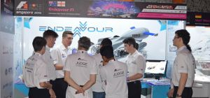 James Rodger (third from left) explains the Emmanuel College's team concept to judges at the F1 in S