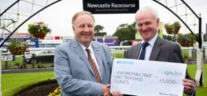 Esh Group Chief Executive Brian Manning (left) receives the cheque from Mike Elliott from Newcastle