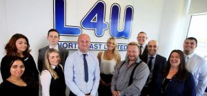 The team at L4U with directors Jon Bell (third from left centre) and Anthony Griffiths
