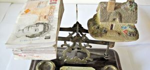 Money and House on Scales