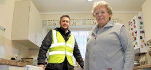 Salix Homes quantity surveyor John Darroch with resident Brenda Holland in her new kitchen
