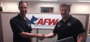Mike Shields (left) and Andy Petherick (right) shake hands on the deal at the AFW headquarters in Ph