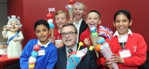 Managing Partner at Higgs & Sons, Paul Hunt, enjoys an 'ice cream' with some of the pupils