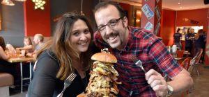 Huckleberry's owners Jon & Sarah Rowlands tuck into 'Burgerpockalypse'.