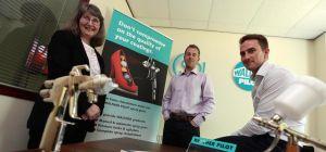 Sue Kirk of UK Steel Enterprise helps Sealpump Engineering Directors Stuart Brown (left) and Stephen