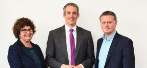 Caroline Pinney and Alex Sealy of Slater Heelis, pictured with Chris Partington (centre)