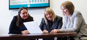 Chris Gray, CEO of CHUF (centre) with Hazel Smith (left) and Anne Hallowell (right) of UNW