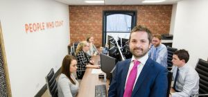 Paul Wintersgill and team in new office.