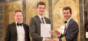 John Bohan, Senior Director at Elevation Recruitment, William Holloway, the winner of the award and