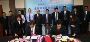 Simon Hare, ASGB and Hu Xi Ming, BISLT signing agreement