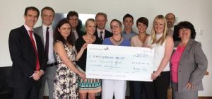 The Baker Tilly 10K team present a cheque to the Hollybank Trust