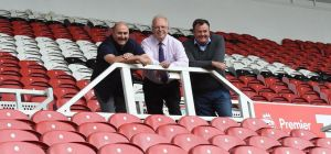 Middlesbrough FC's chief operating officer Mark Ellis (centre) with Steve Macdonald (right) and Step